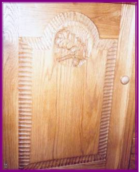 A close up of the door of the dresser