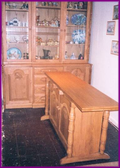 An carved oak dresser and table I made .The table opens out to seat 6 with the settle in, in the picture below,  on one side